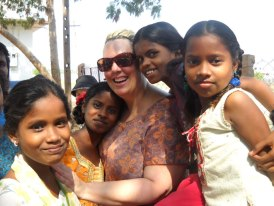 Phenix Salon Suites' Marchelle Locke with India's 'untouchable' children.